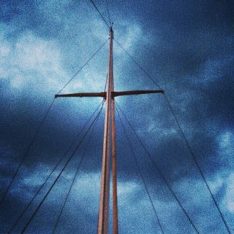 sailboat mast storm clouds